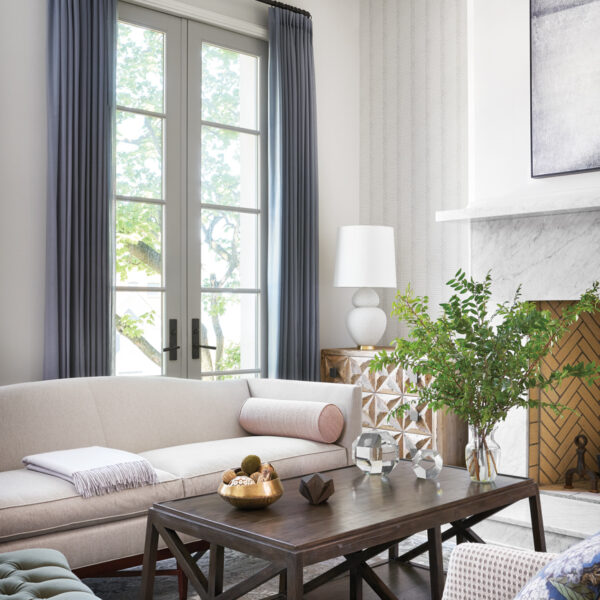 Who Says A Family-Friendly Home Can't Have Glam Accents? This Chicago Abode Gets It Right. bolier sofa and bernhardt swivel chair living room