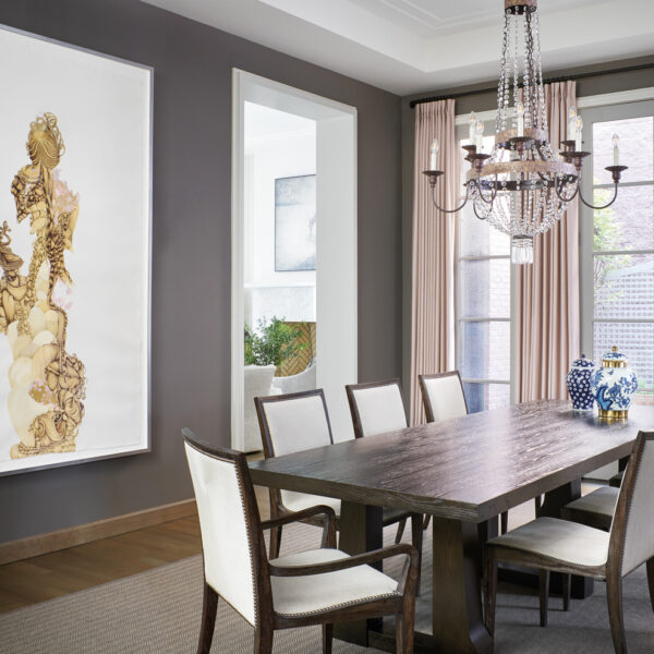 Who Says A Family-Friendly Home Can't Have Glam Accents? This Chicago Abode Gets It Right. dark gray dining room with robert james wooden table
