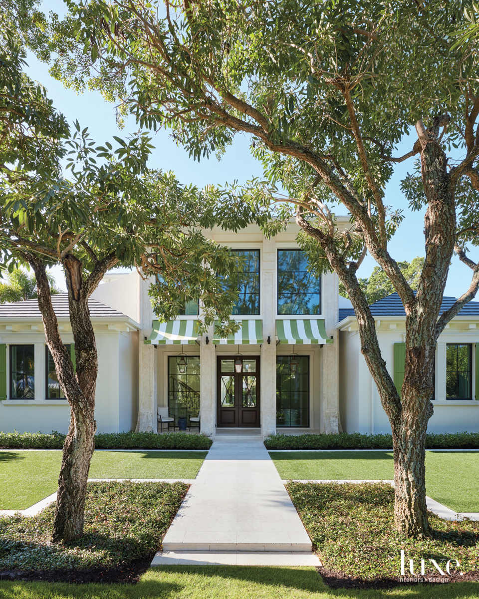 naples home exterior with stripped...
