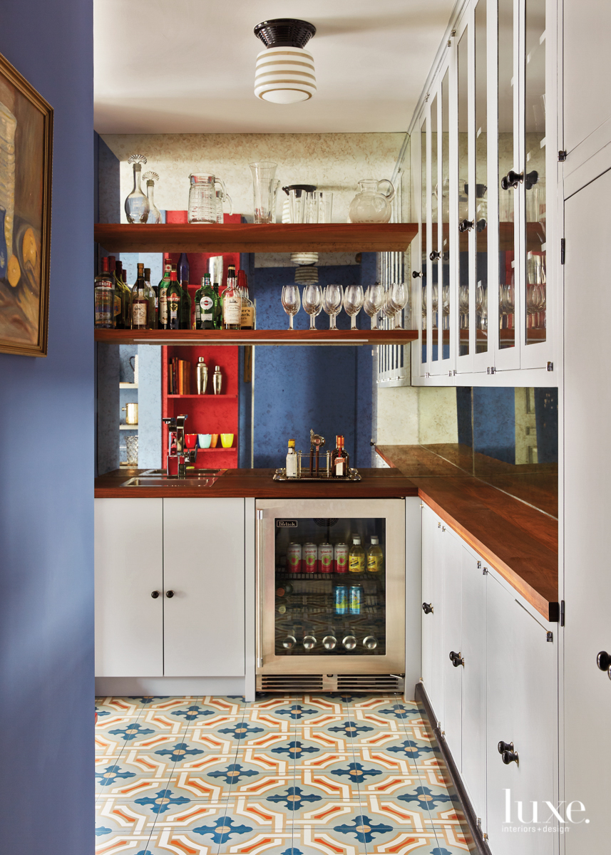 blue walk-in wet bar with...