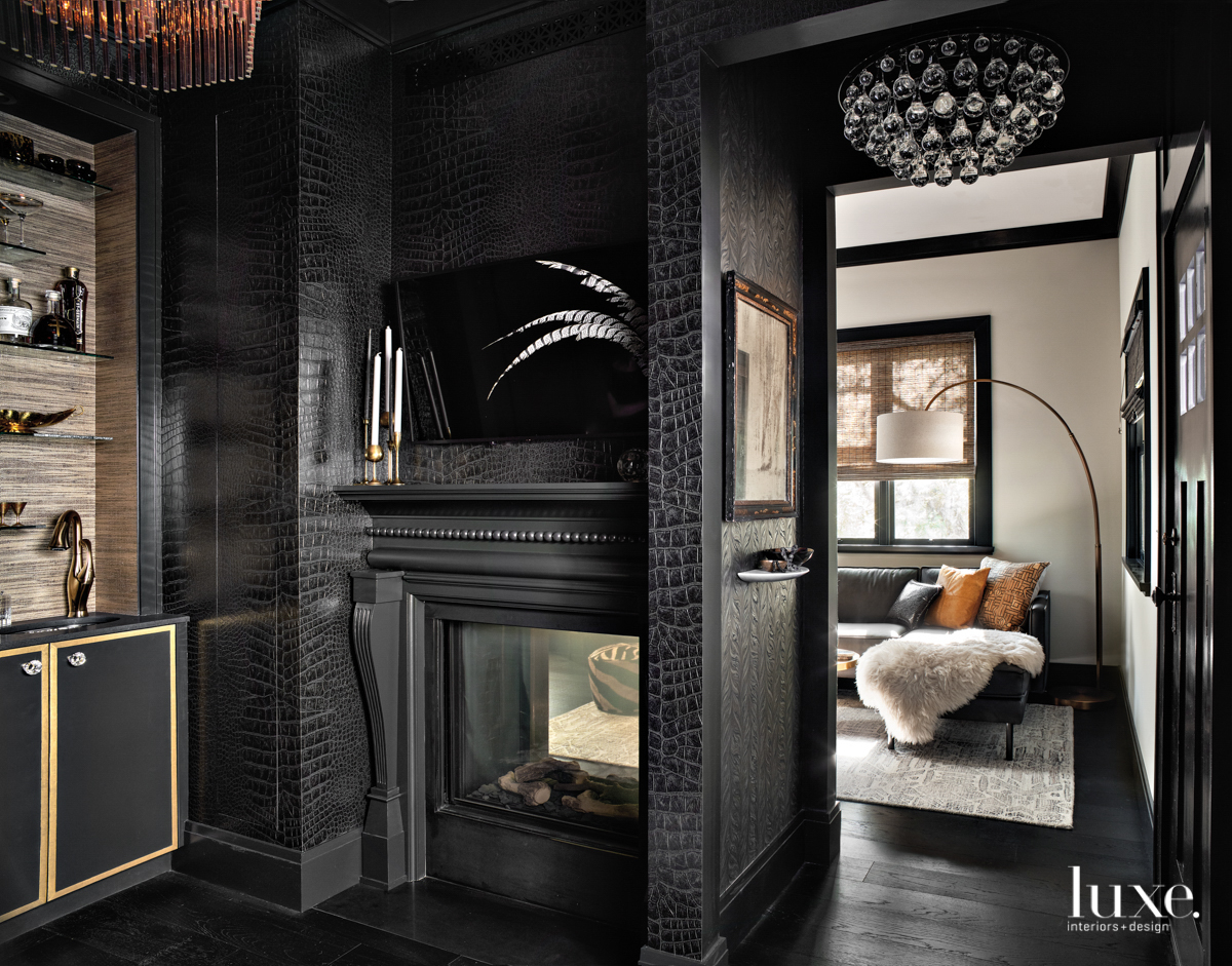 black carved fireplace surround with...