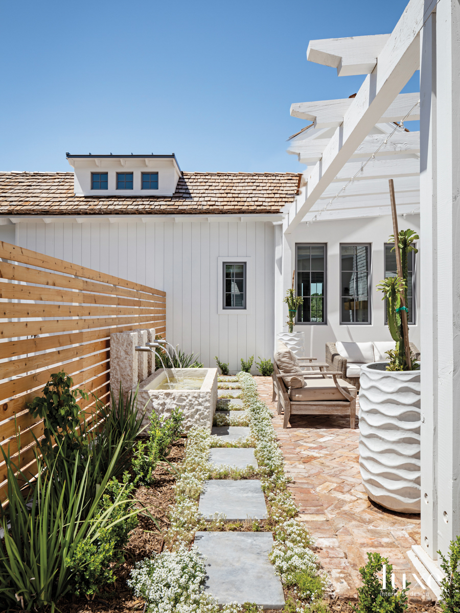 side courtyard features the landscape architecture and fountains