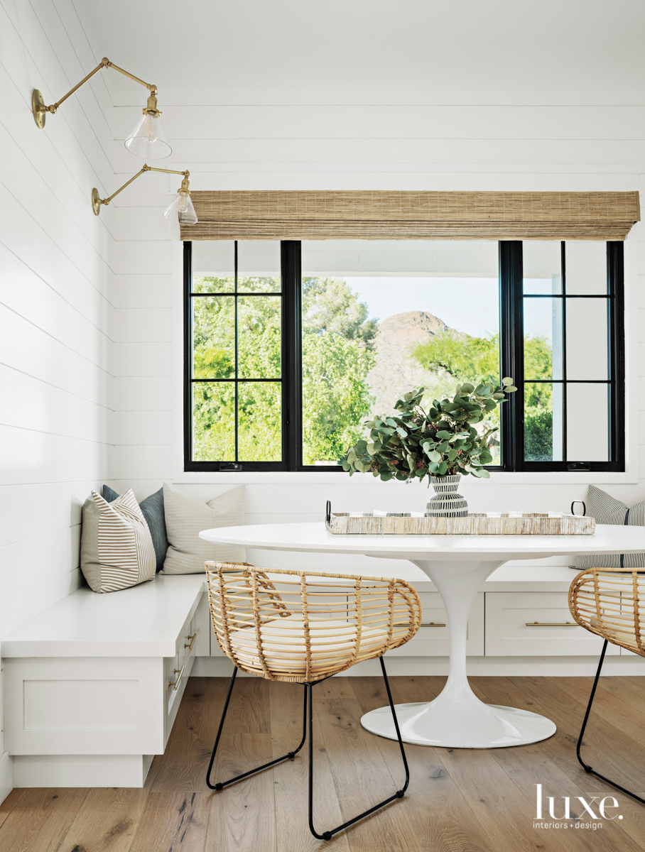 breakfast nook with a open window and bench seating and overhead lighting