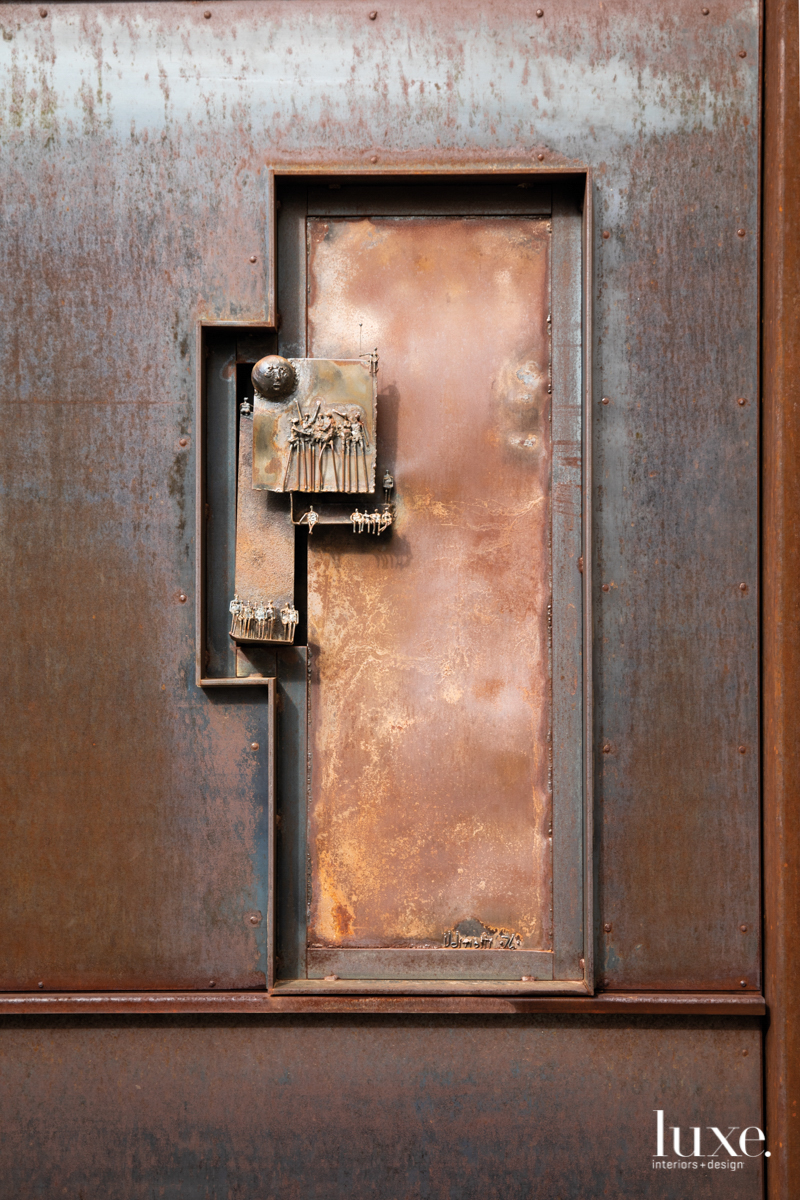 steel door with archaic touches
