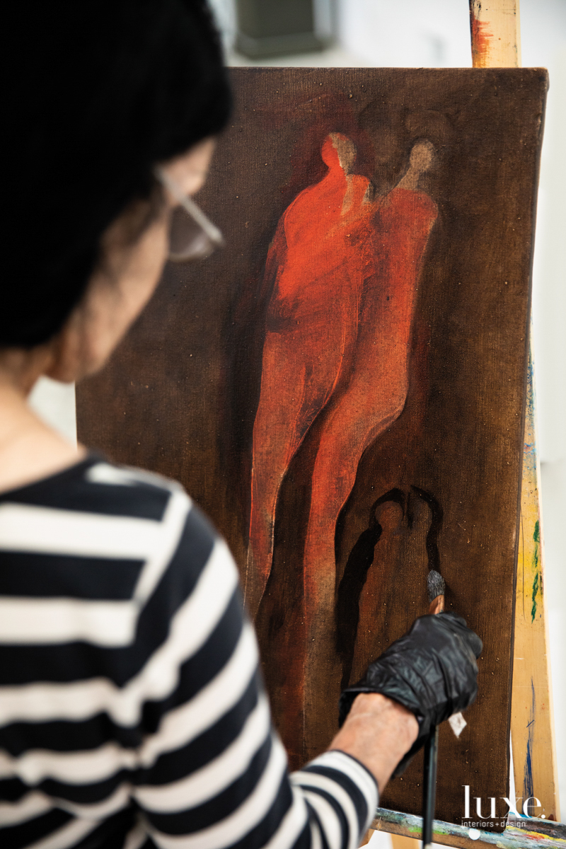 udinotti painting an image of red figures