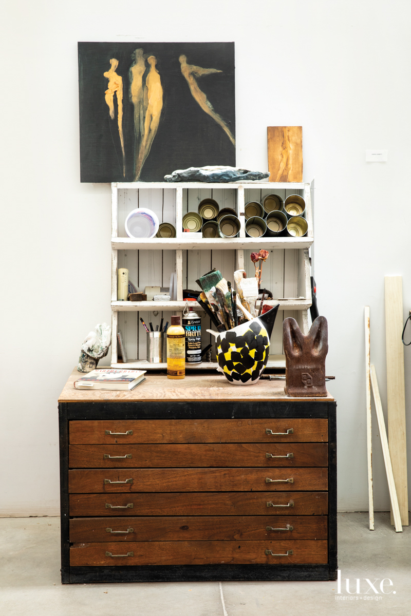 drawers and storage with paint cans, brushes and pieces of art
