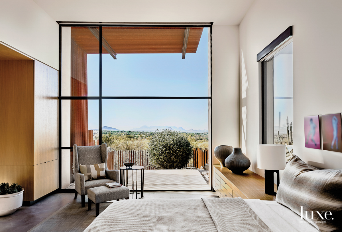A steel-and-glass wall provides dramatic...