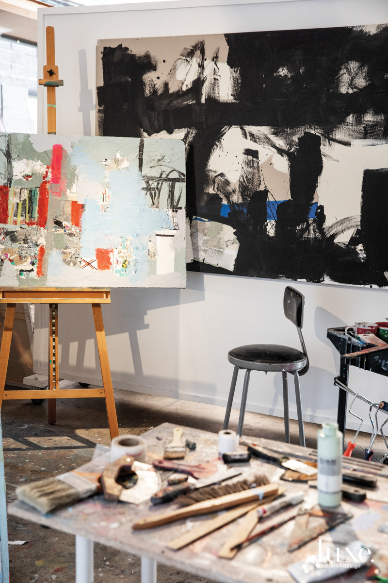 A finished painting hangs behind a work in progress in Viglietta's studio.