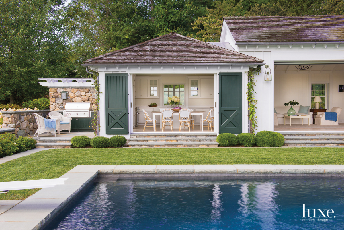 Behind The Charming Pool House Becomes A Family's Destination For Year-Round Entertaining