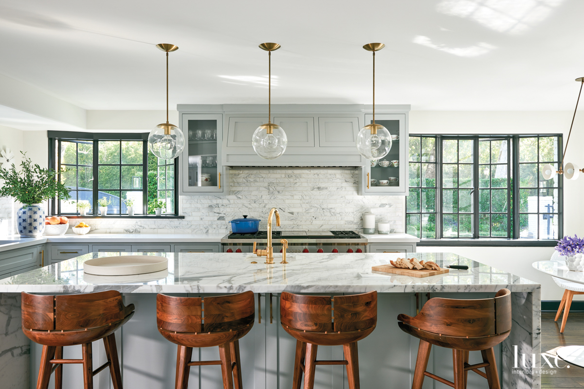 kitchen with circular light pendnats,...