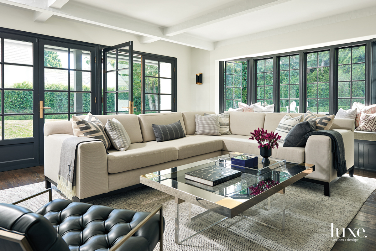 family room with a sectional...