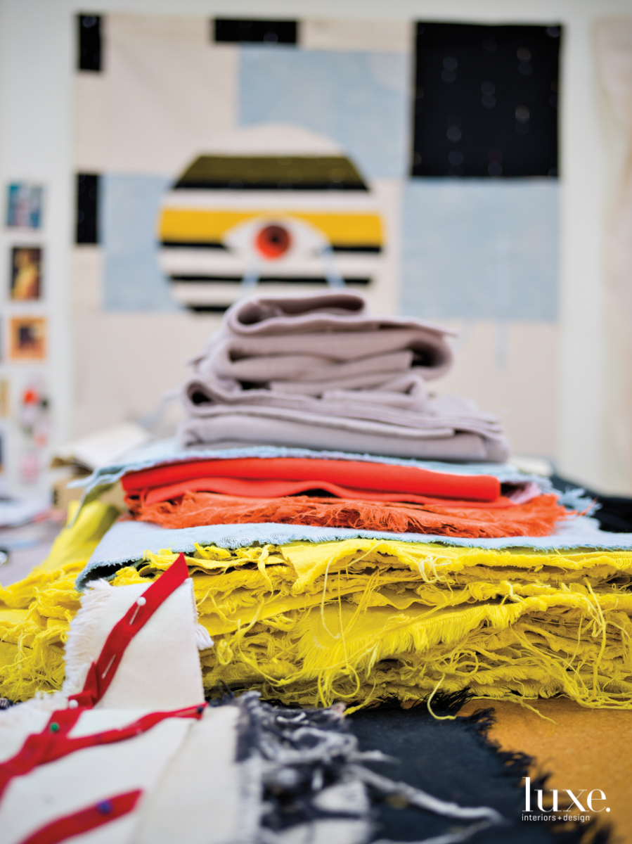 colorful fabrics stacked on top oof each other, red, yellow and blue