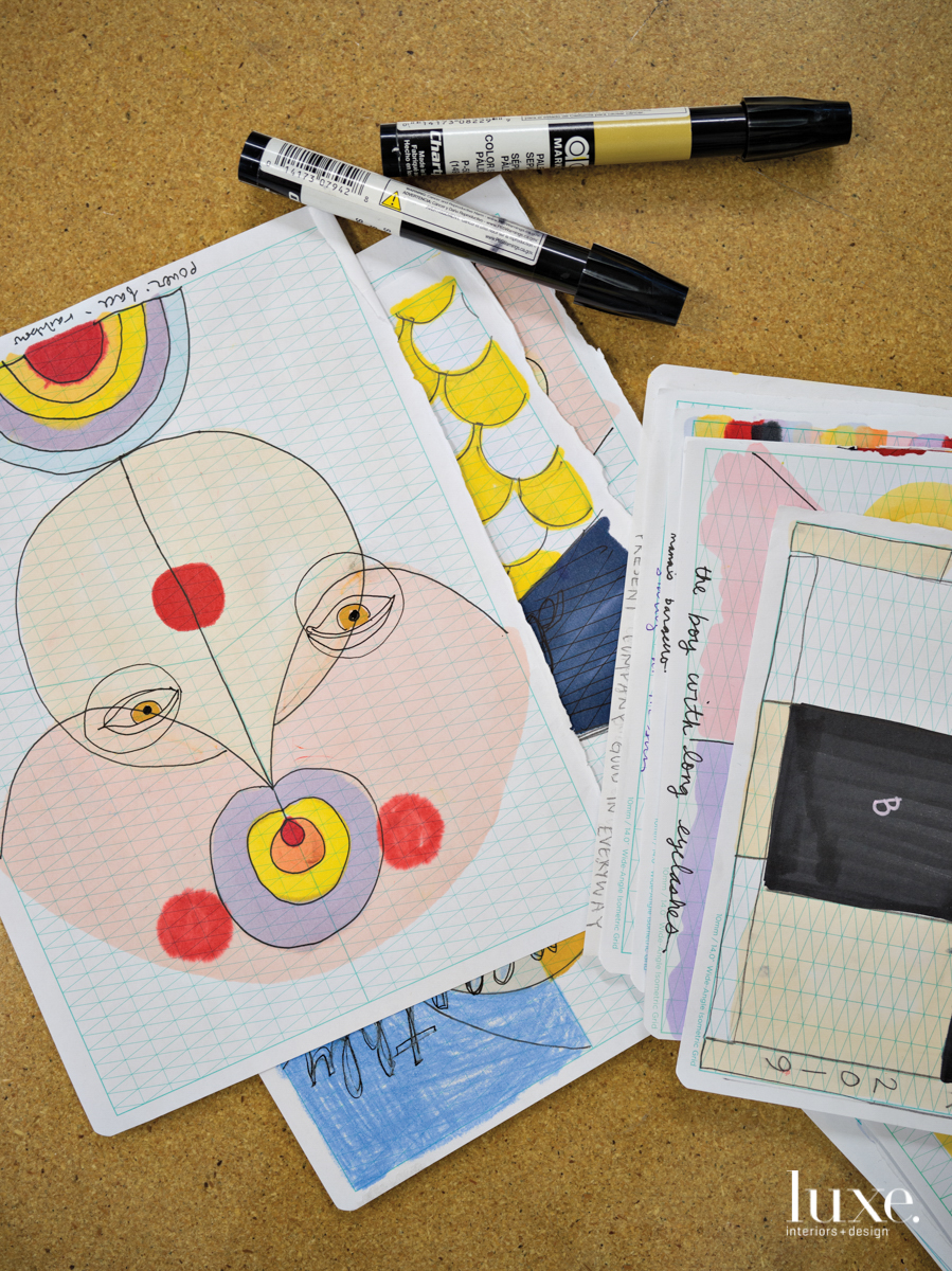 paper with drawings on them with markers