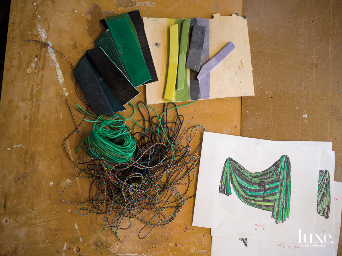 Small-gauge rope, pieces of plywood and a sketch sit on Dan Gunn's table.