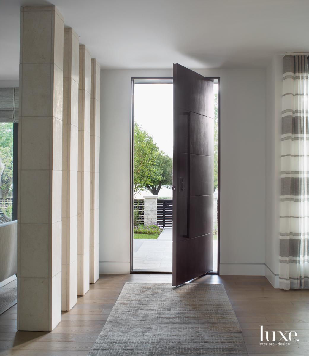limestone columns entryway with walnut...