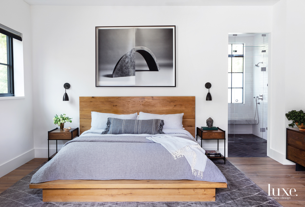 master bedroom with wood bed,...