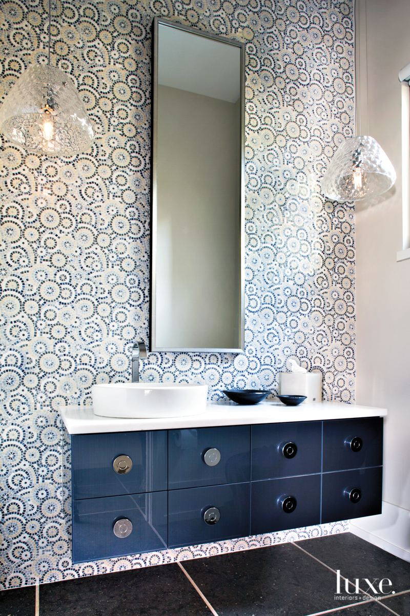 A powder room features an...