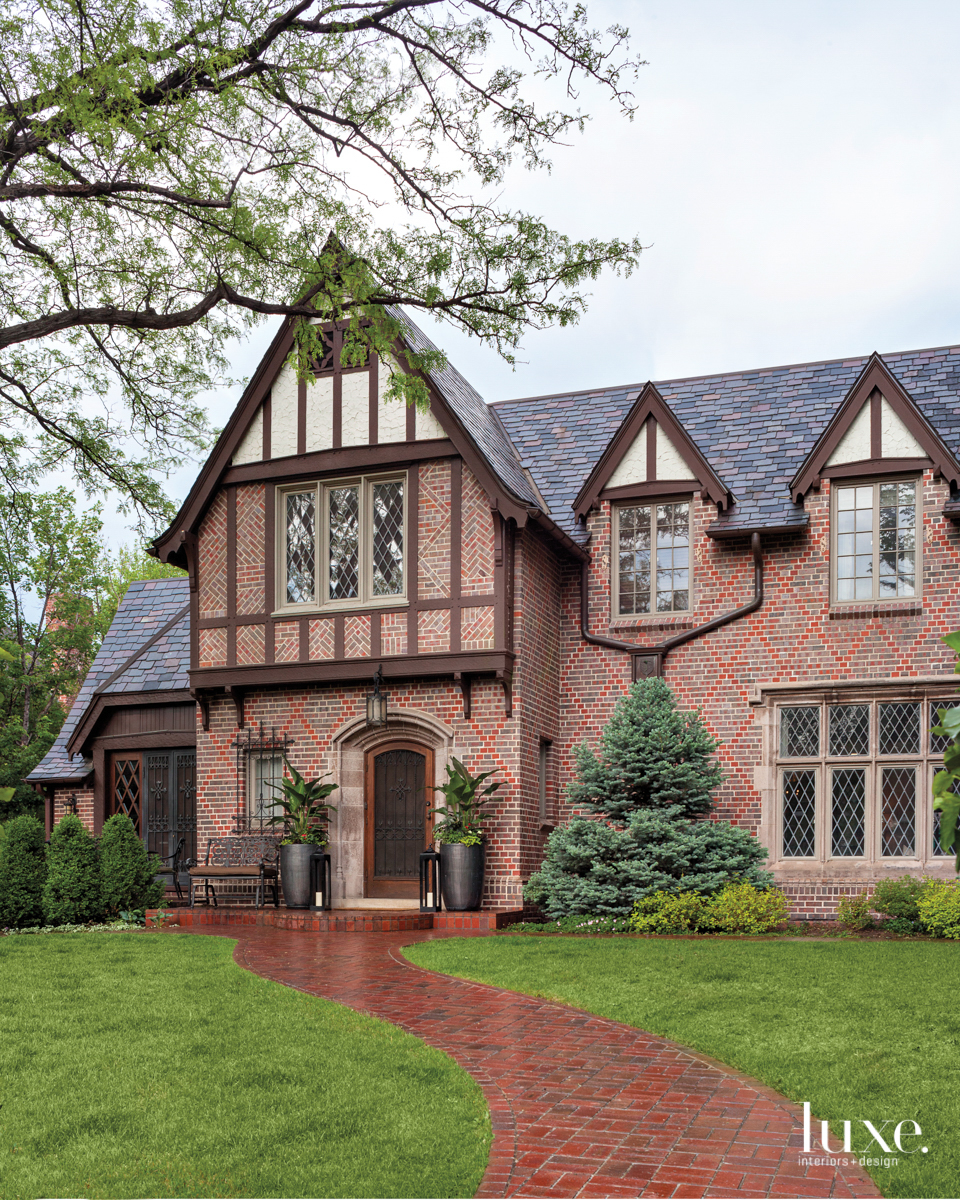 The exterior of this Tudor home in Denver is composed of red brick and wood timbers.