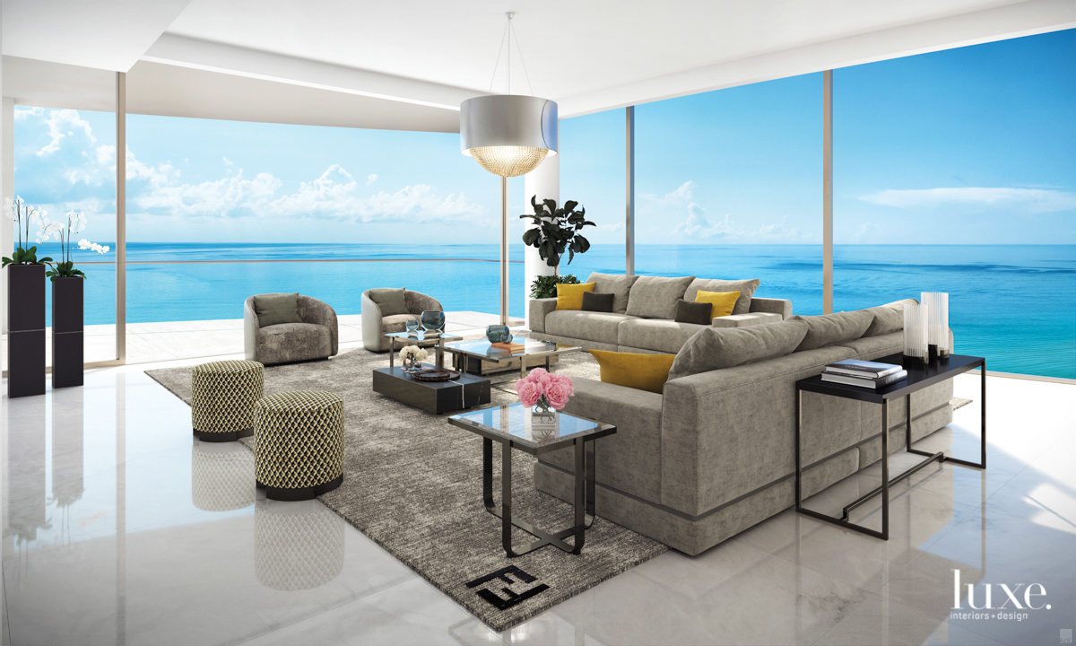 view of the ocean from living room with couches