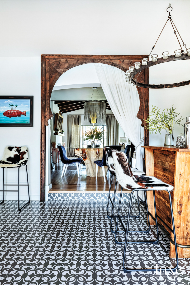Bar with cowhide chairs and Spanish tile flooring