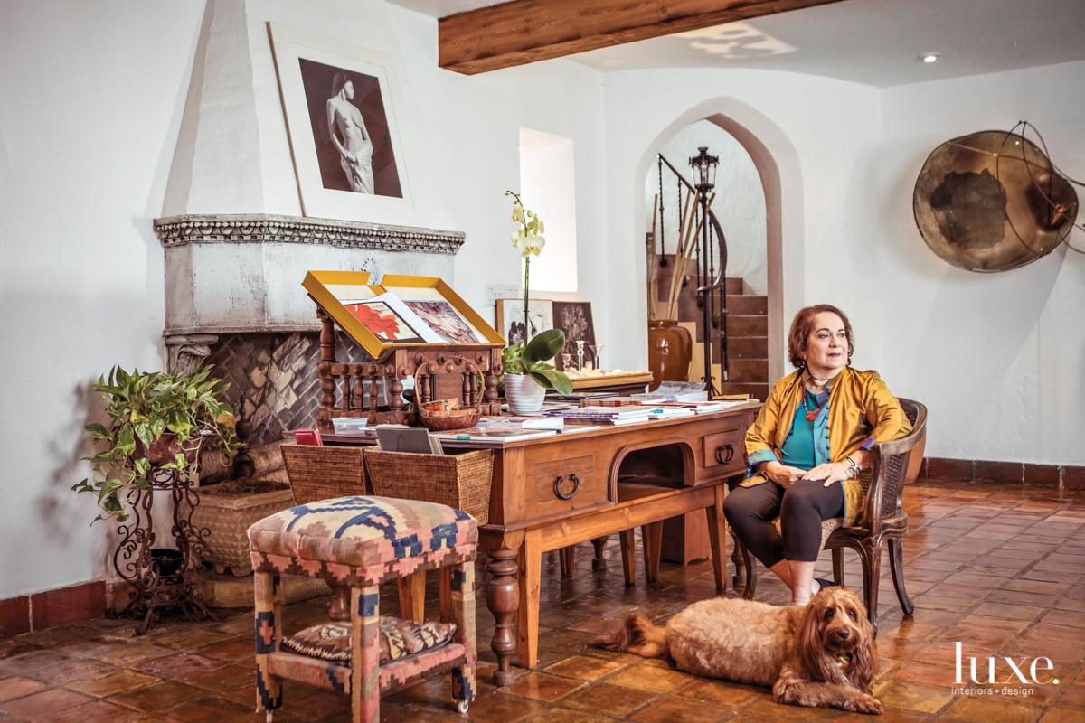 Mira Lehr and her labradoodle in her Miami Beach studio