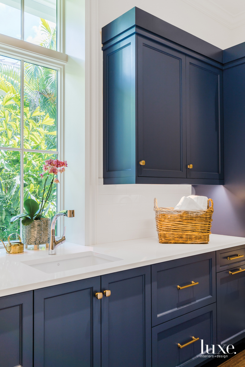 laundry room with deep blue...