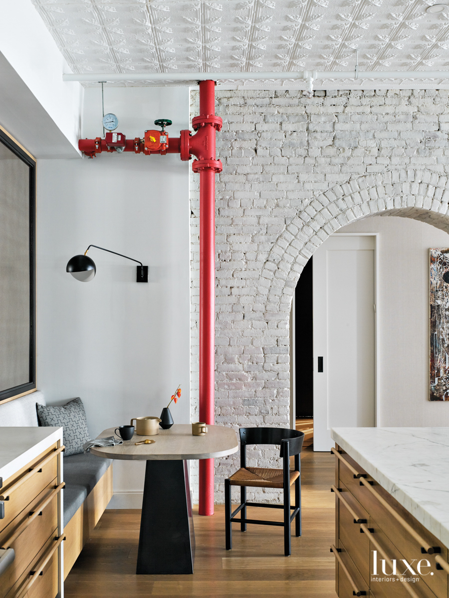 breakfast nook with red pipe...