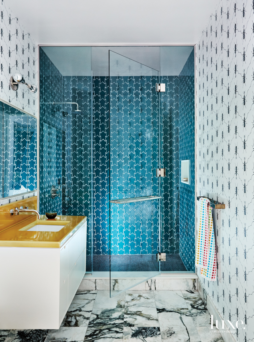 bathroom with blue tile shower...