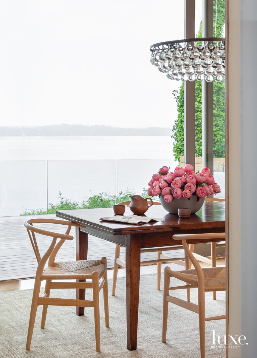 farmhouse table outside overlooking lake