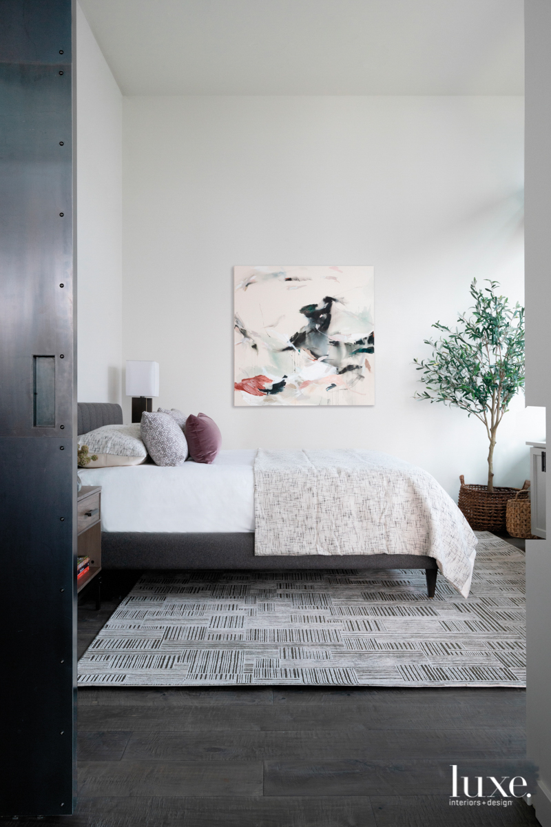 light gray master bedroom with...