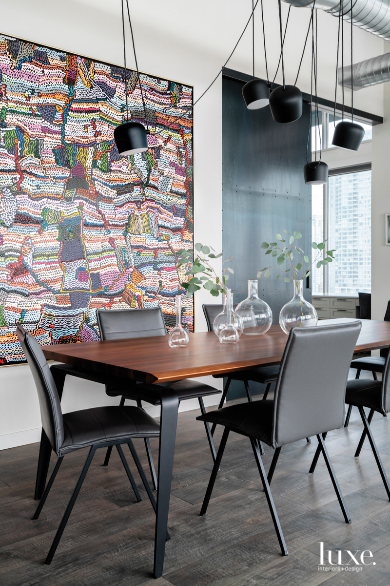 dining rom with black pendants...