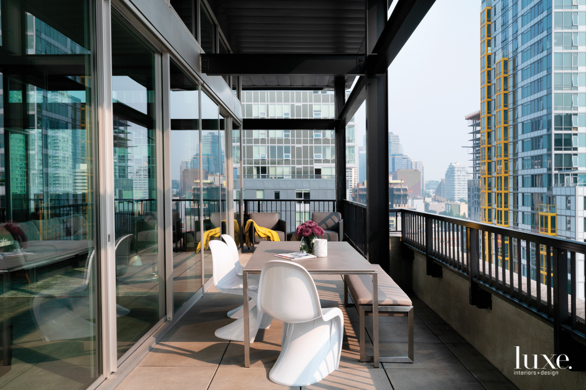 penthouse wraparound deck with outdoor table