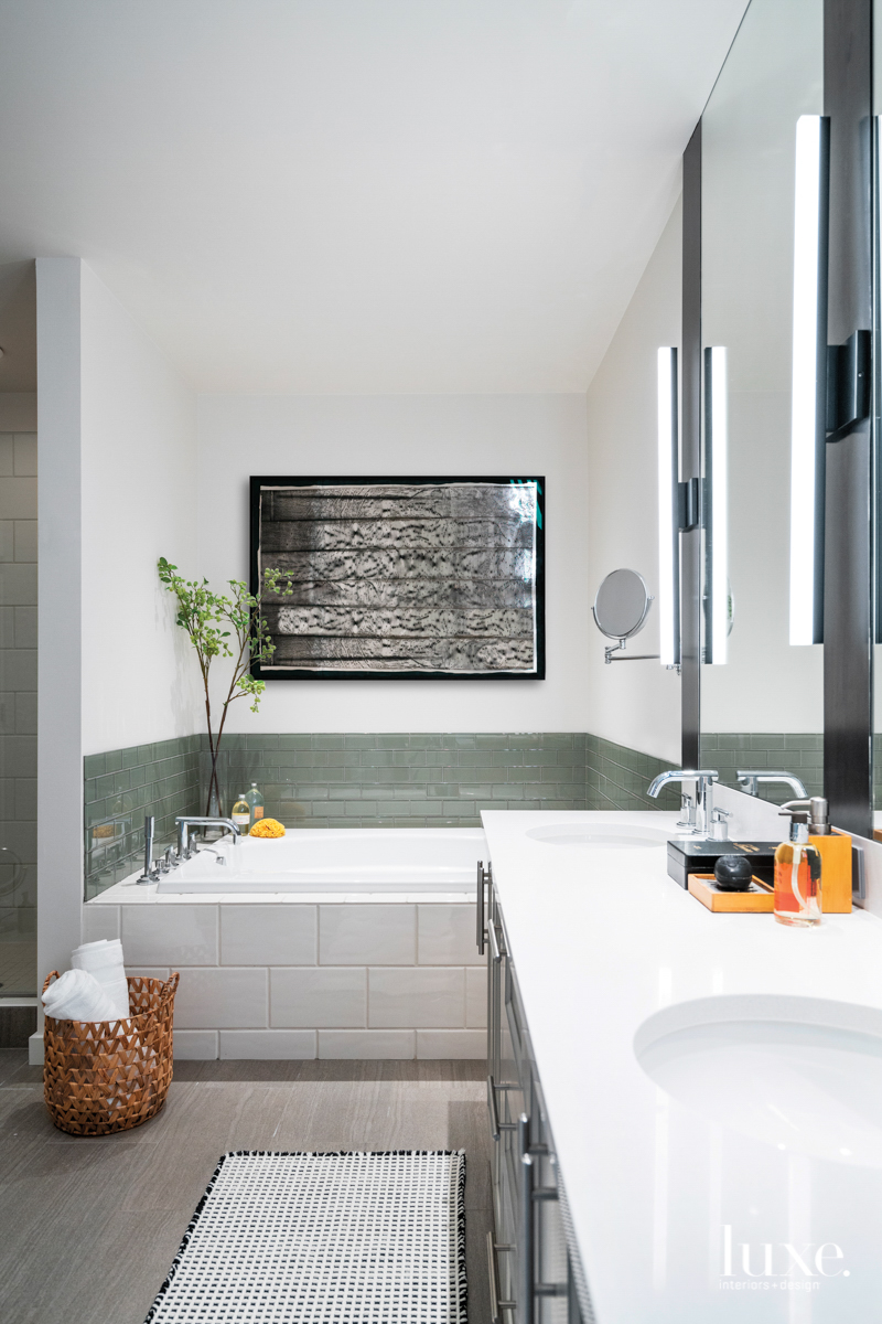contemporary master bathroom with green...