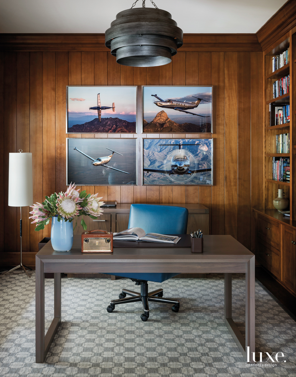 Wood paneled office with desk...