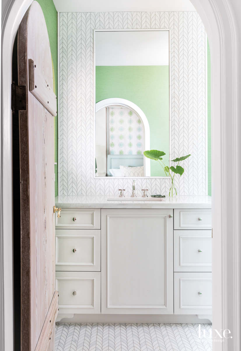 bathroom with green walls, white...
