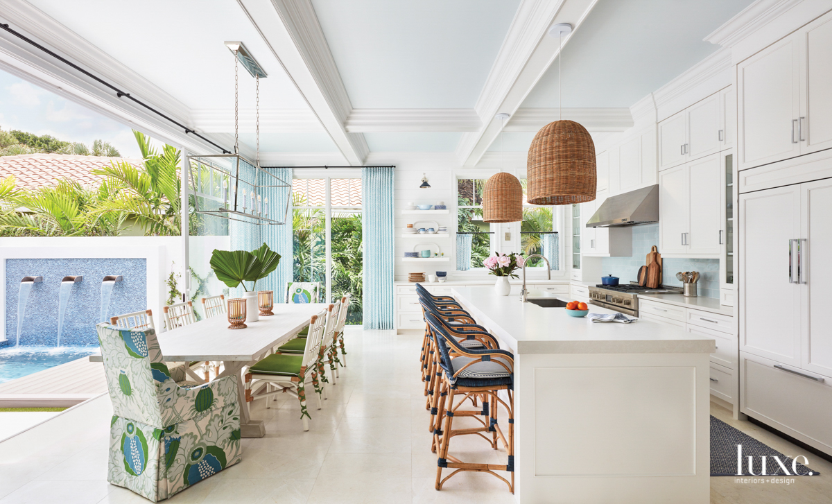 White kitchen and dining area...