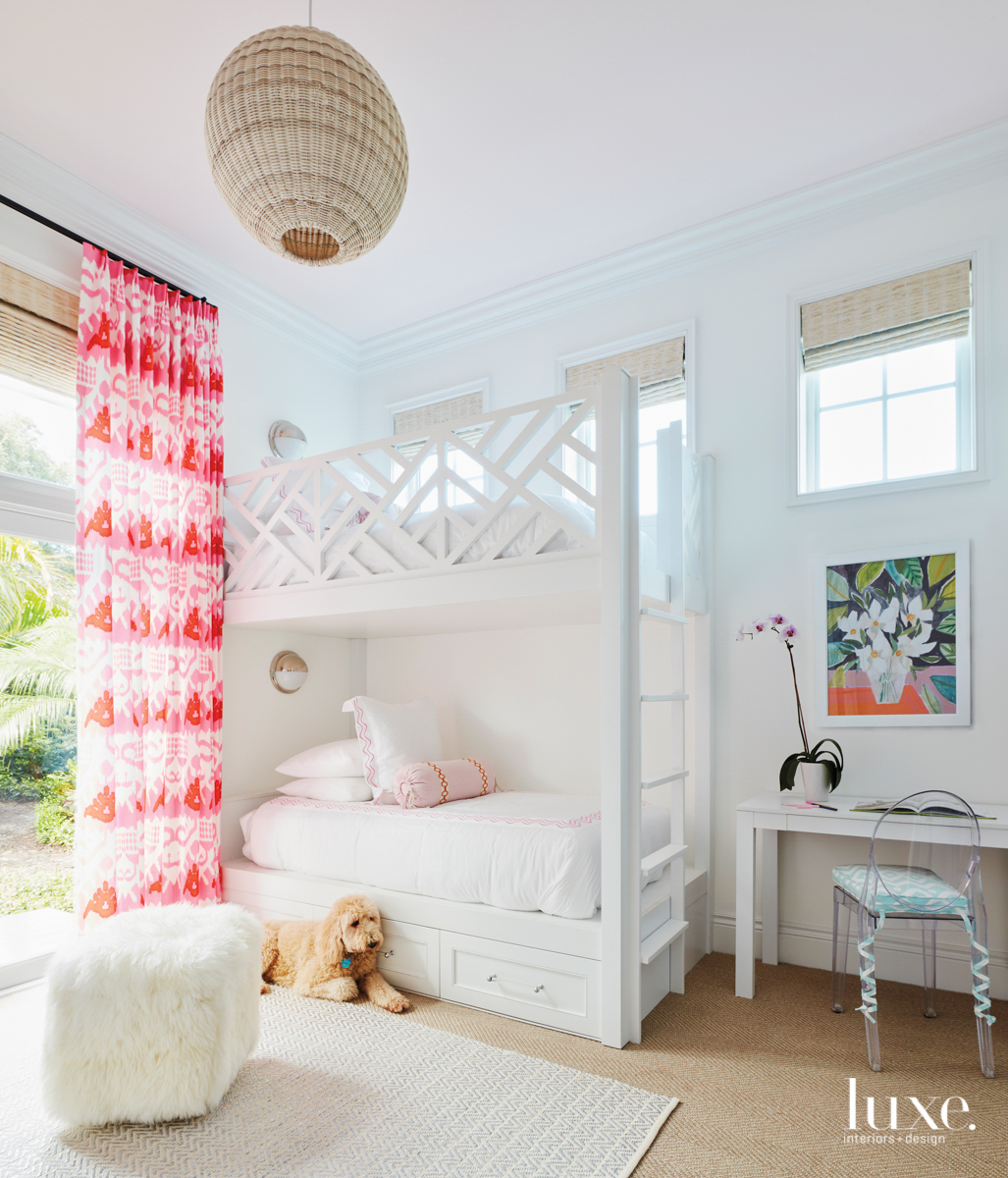 Bedroom with white chippendale-style bunk...