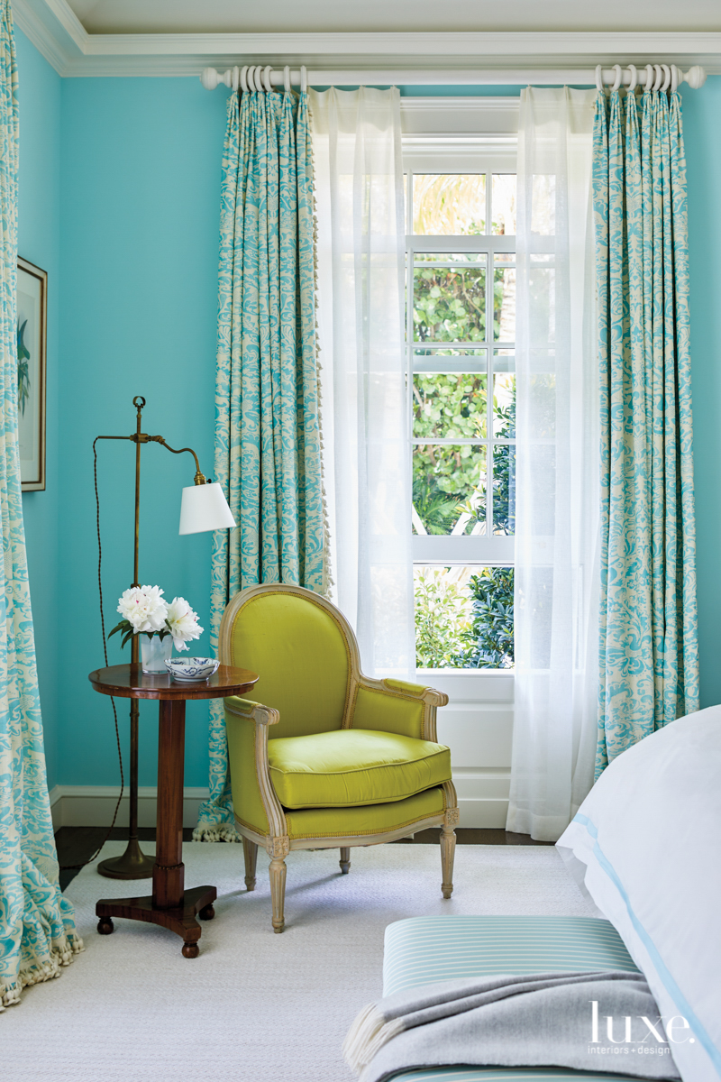 green armchair in aqua bedroom