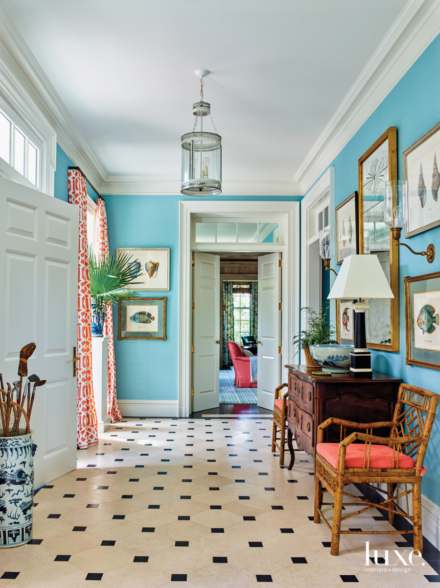 foyer with aqua walls and...