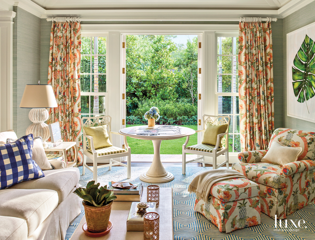 coral patterned draperies and chaise