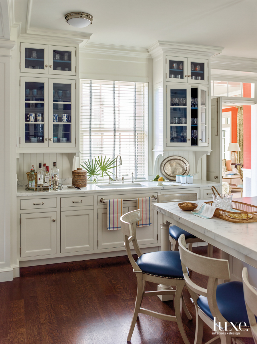 white kitchen with blue cabinetry