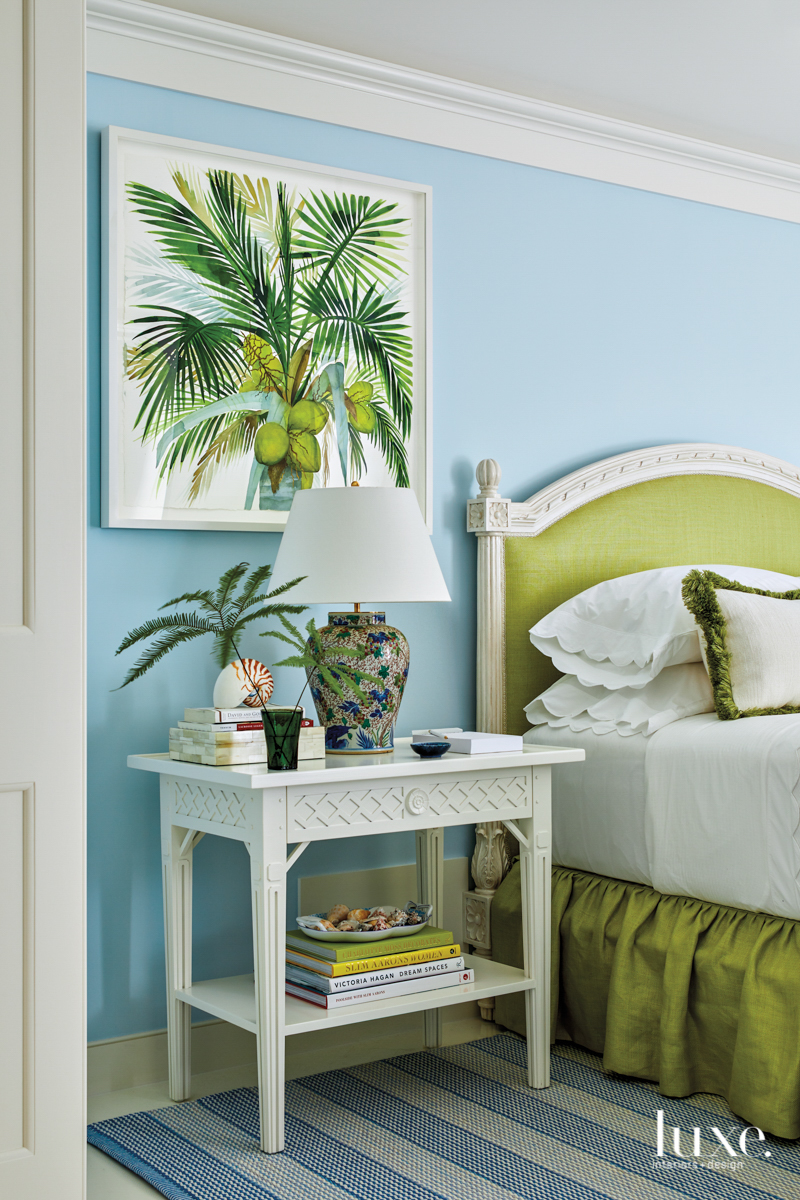 bedroom with light blue walls,...