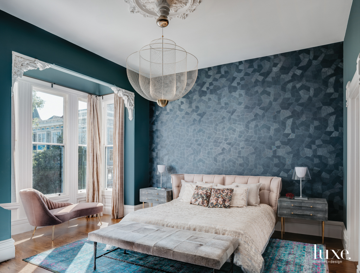 master bedroom with blue wallcovering...