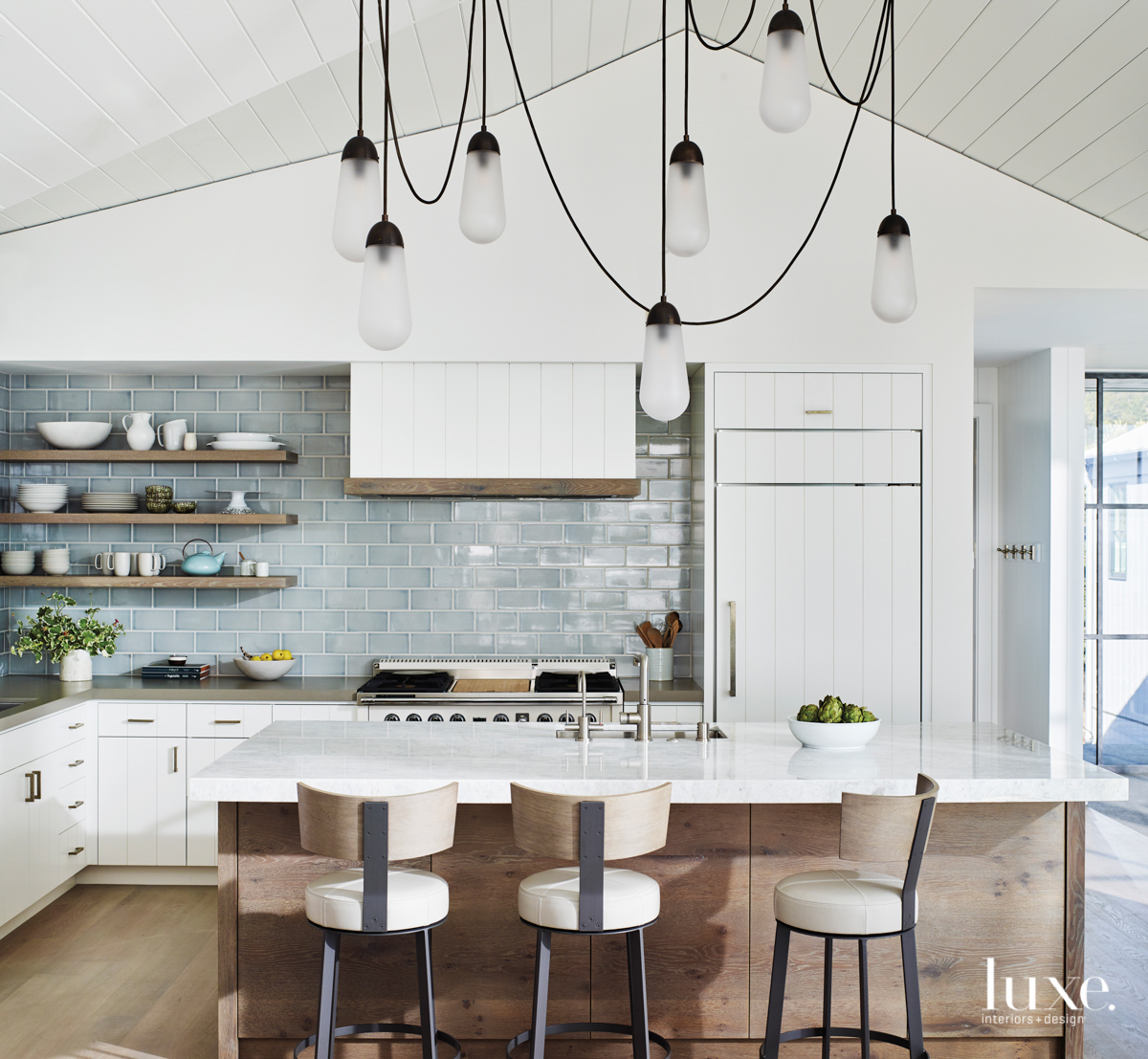 A kitchen is accented with...