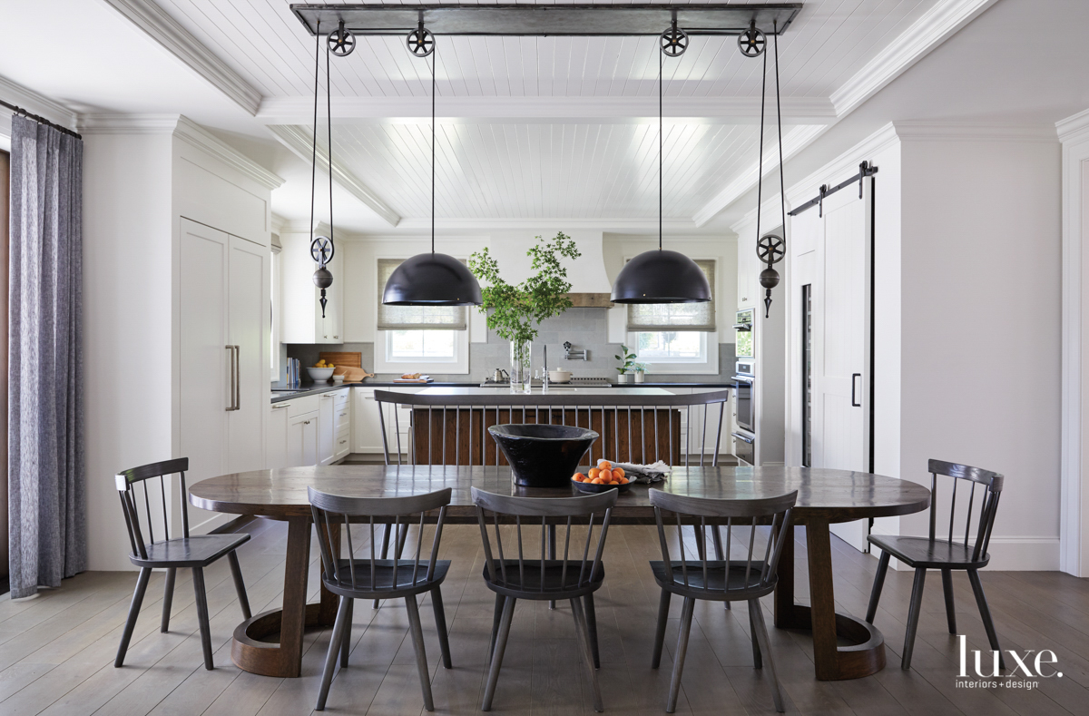 A kitchen seating area has...