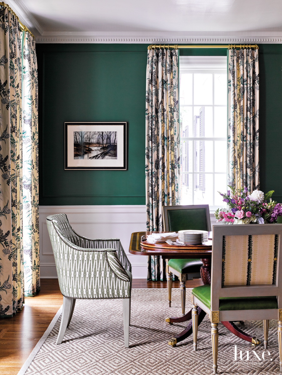 dining room with dark green...