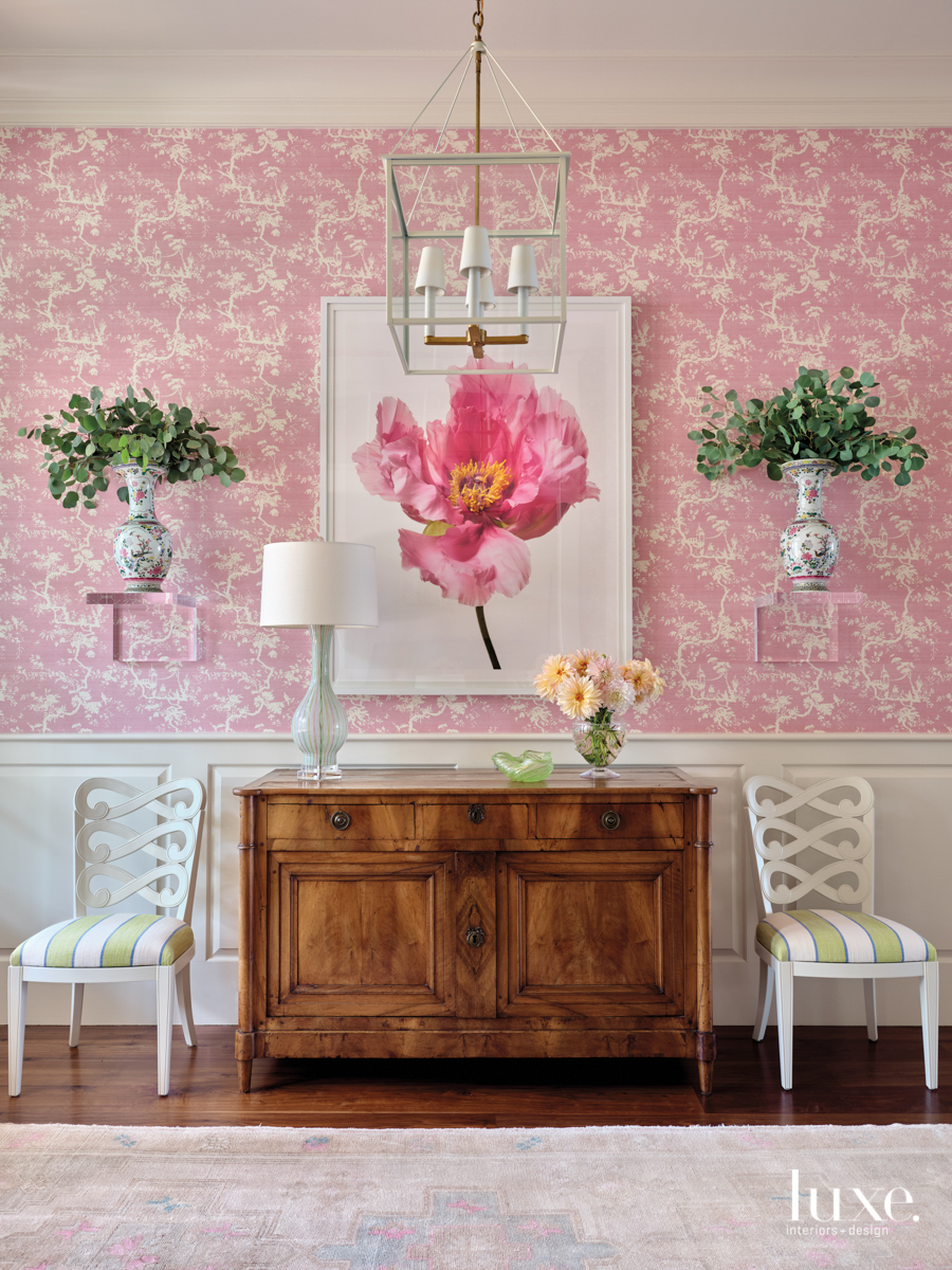 bright pink entryway wallpaper with...