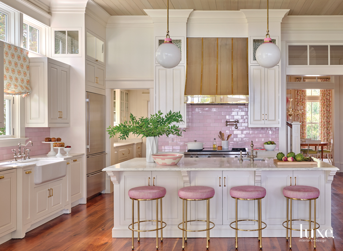 kitchen with pink backsplash and...