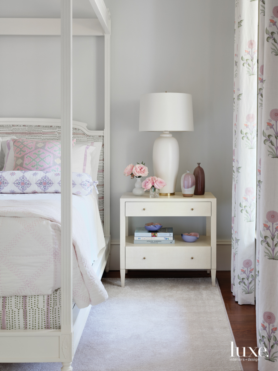 white guest bedroom with floral...