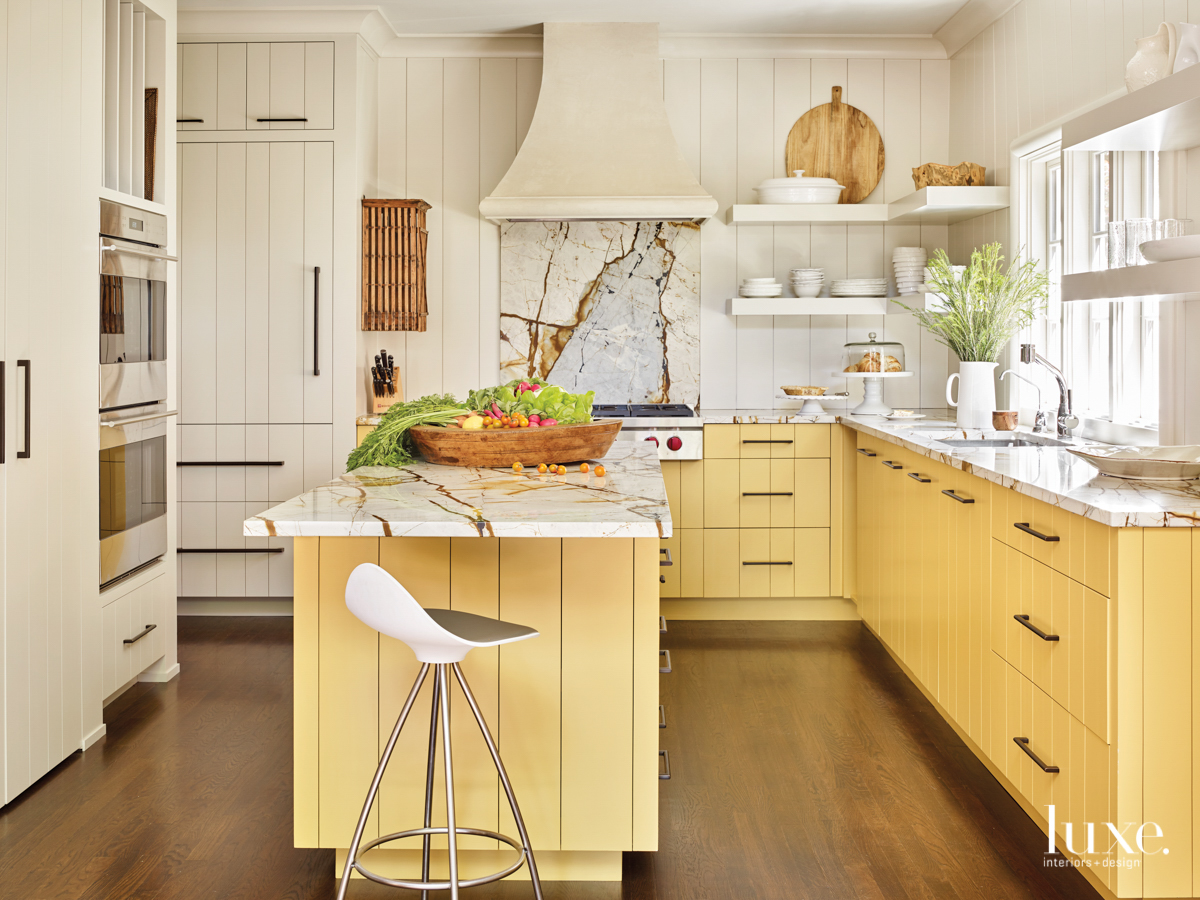 sunny kitchen with yellow cabinets...
